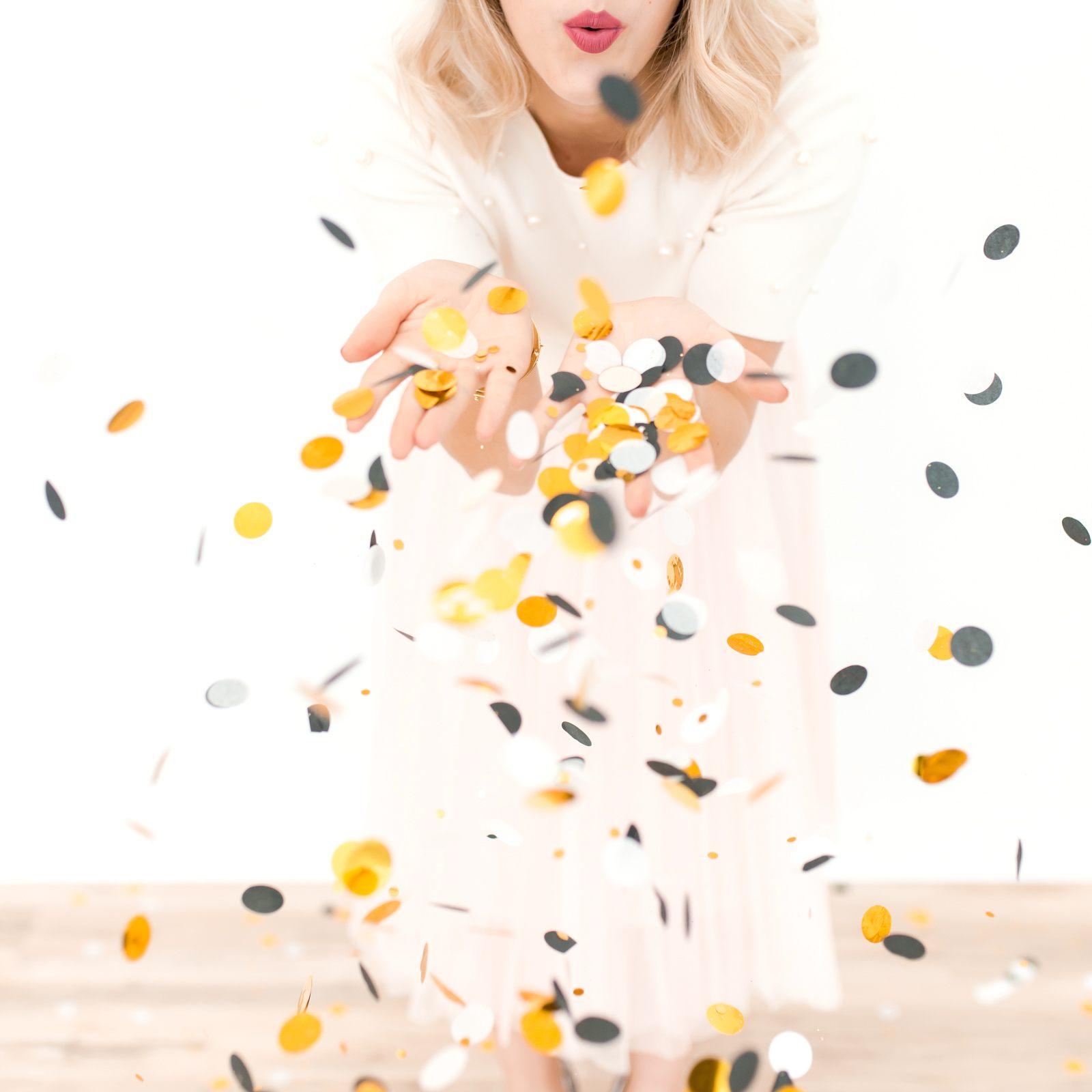Woman throwing confetti