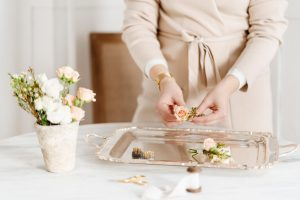 Woman's hands arranging flowers