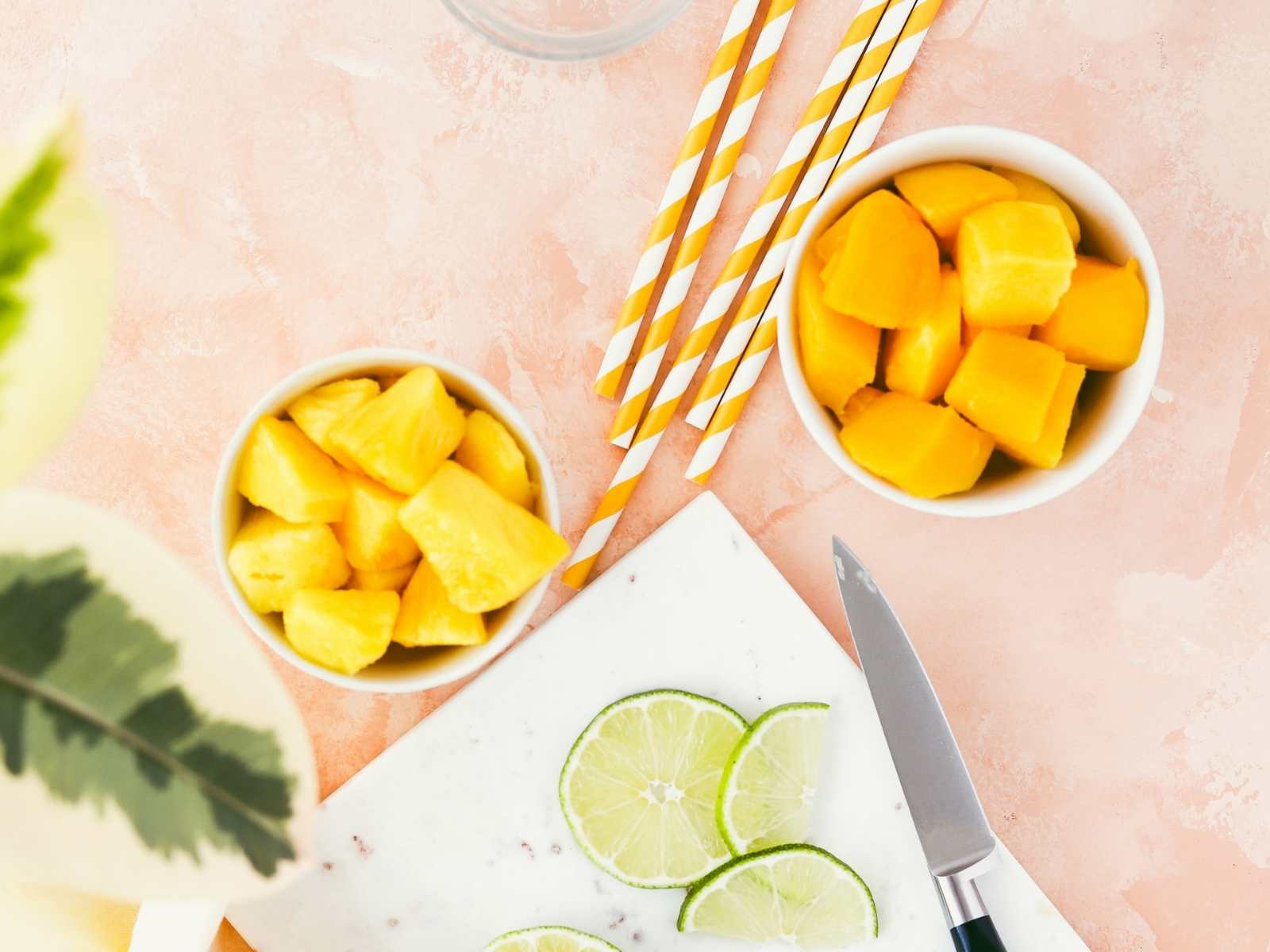 mango pieces and lime slices on a counter