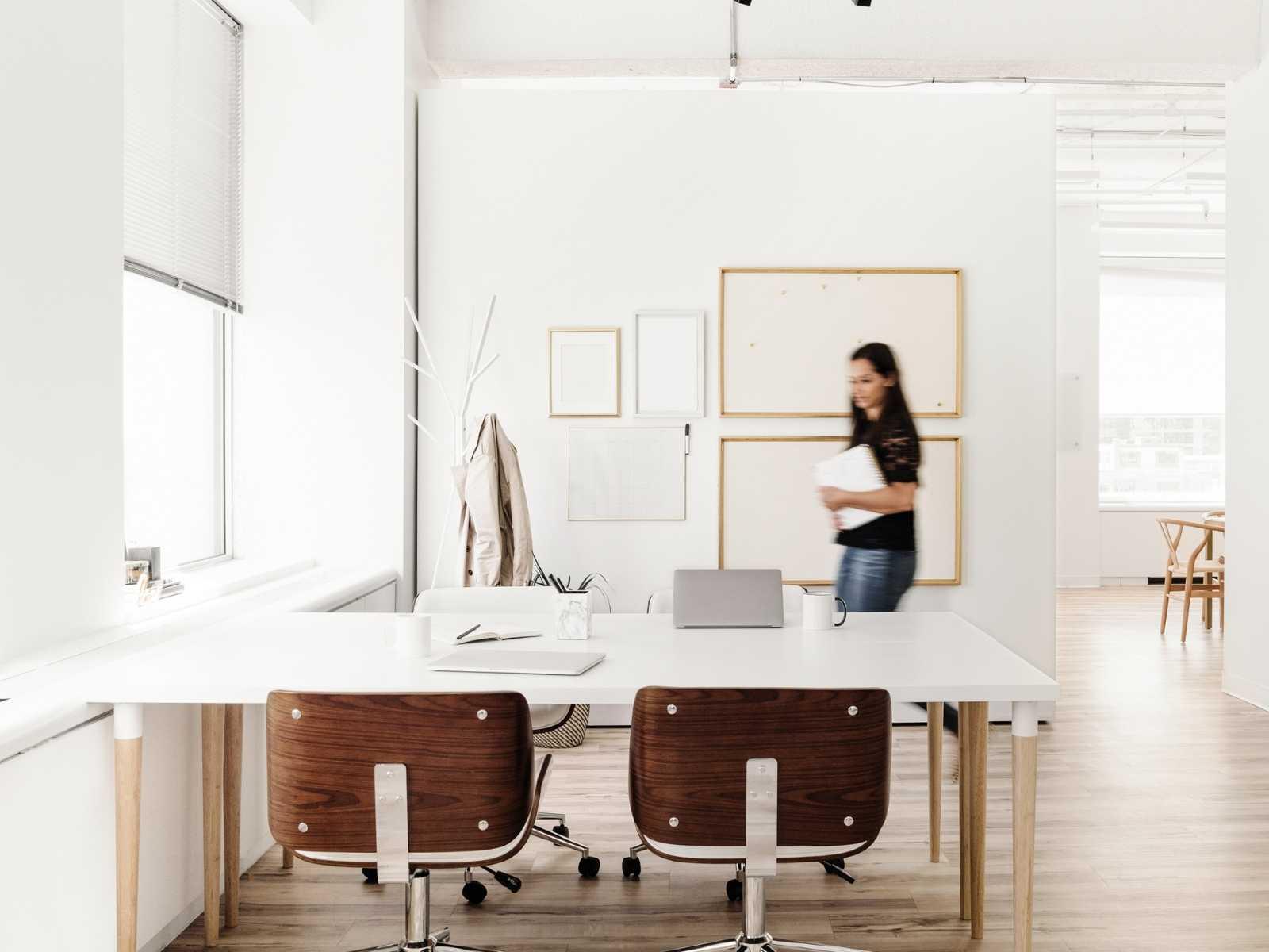 Woman rushing around office